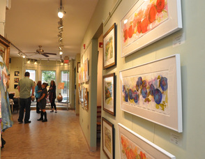 "Fresh produce and farm scenes line the walls of TraillWorks for the ""FRESH"" Exhibit."