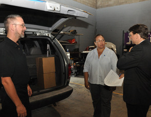 Zaida Collazo with Extreme Energy Solutions' Bruce Dillon, and Samuel K. Burlum.