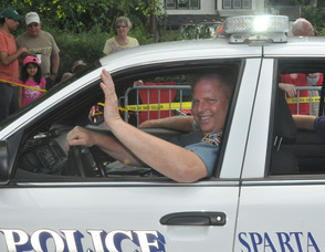 Sparta Police Chief Ernest Reigstad waves to the crowd.