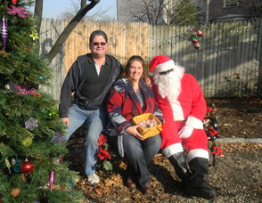 Chatham Chamber of Commerce members Michael Goodnight and Carolyn Cherry with Santa