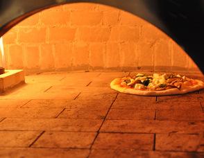 A pizza bakes in Kings Food Market in Livingston.