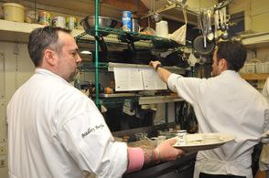 Chefs team up in the kitchen.