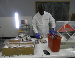 Blood Collection Support Staff Driver Tyrese Chamberlain  processing the blood
