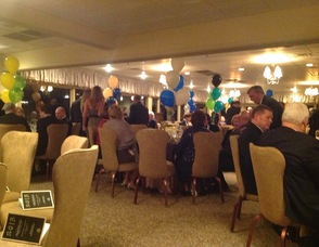 Attendees gather in the dining room to enjoy the festivities.