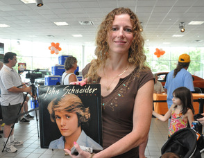 Evelyn Francisco with her John Schneider album.