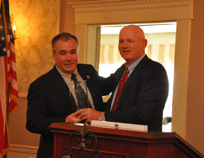 Chuck Roberts presents the award to Commissioner Hal Wirths for Business Advocacy.