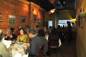 Diners at the event in one of Andre's Restaurant & Wine Boutique's dining room.