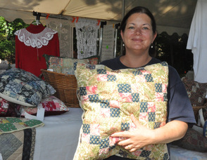 Wendy Van Dame of Mountain Lakes, NJ, with some of her quilted works.