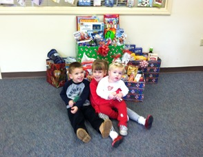 Pictured is Sussex Bank's Vernon Branch collection items.  Photo caption left to right: The Kimkowski Family - Nathaniel, Samantha & Julia (Sussex Bank customers)