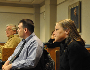 Scott Harris and Kathi Unangst wait in the courtroom for the proceedings to begin.