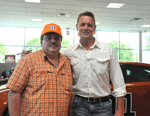 Joe Prudente, a fan, poses with John Schneider.