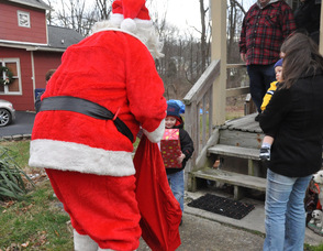 Santa makes a stop to the home of Ryan and Jacob Garrigan, ages 3 and 1.