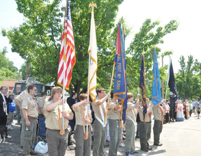 Local Boy Scouts hold the flags during the ceremony.