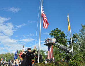 The flag being raised.