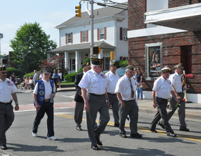 Local veterans march by the Newton Theatre.