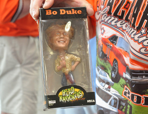 Brian Kapral holds up a Bo Duke Bobblehead.