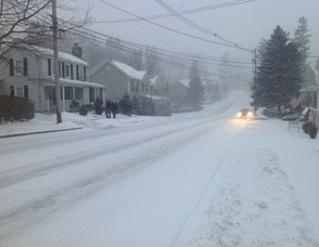 Trinity Street in Newton as snow falls this afternoon.