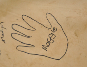 "Maggie Fisher's handprint on the flip side of the ""HOPE"" Mural."