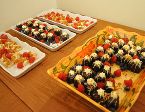An array of dessert items interspersed with farm fresh berries.