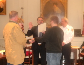 Volunteer Firefighter Colin Dunne being sworn in