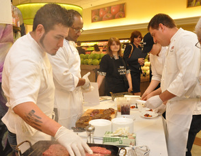 Chef Bill Zucosky and staff preparing Prime New York Strip Steak.