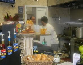 One of his employees preparing food
