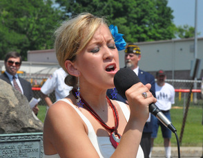 "Mary Adams sings ""God Bless America""."