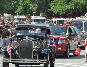 A sea of Sparta Fire Department trucks, preceded by an antique car.