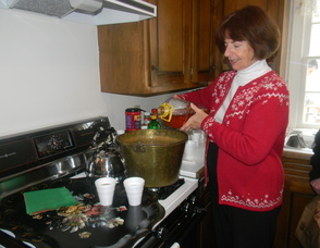 one of the Historical Society members making cider