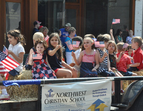 Northwest Christian School students wave their flags.