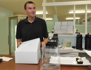 Chip Schaffer boxes up some cupcakes.
