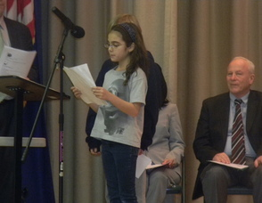 A fifth grade student reading a poem about eating helathy