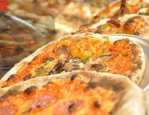 An assortment of pizza.