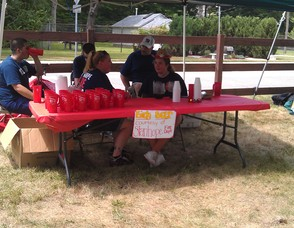 Members of the Stanhope Fire Department give away free birch beer to the residents.