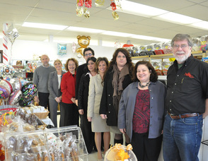 Inside the store, from back to front:  Frankford Township Mayor Gary Larson, Linda Barry Member Services Coordinator of the Sussex County Chamber of Commerce, Eileen Diehl from Lakeland Bank, Cody Halligan,Pat Halligan-Kissel owner,  Tammie Horsfield President of The Sussex County Chamber of Commerce, Gabrielle Gudd of The New Jersey Herald, Rose Marie Paolucci of Valpak,  and Don Hall from The Chatterbox.