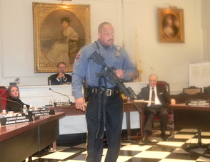 Madison Patrolman Kevin Boone demonstrating how assault weapons are used