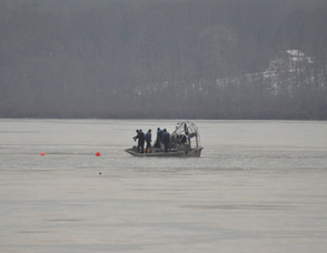 The police work on location after laying down buoys.