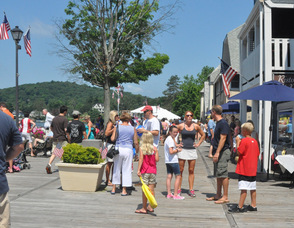 Spectators gather at the Boardwalk for the Ski Hawks show.