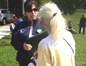 Michelle Casalino, Left, Speaks to West Orange Resident