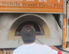 making pizza in the wood oven