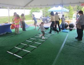Kids running through exercise drills