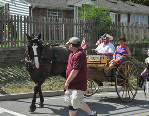 Parade Grand Marshal, Marianne Dilworth, paraded by in horse drawn carriage.