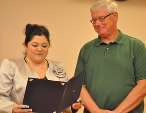 Mayor Helen Le Frois presents Bob Caffrey with a proclamation for his volunteerism to the town.