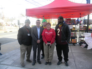 Walgreens Store Manager Chris Morgan (center) with employees