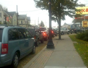 Cars wait bumper to bumper to fill at Newton's Lukoil.