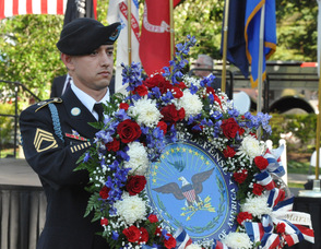 Matthew D. Neuenfeldt, Army Staff Sergeant, carries the Military Wreath.