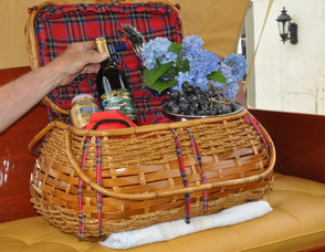 "A picnic basket in the back of ""Golden Years"", filled with a wine commemorating the boat, and flowers grown by Sam Hoagland, the boat's owner, who is also a Master Gardener."