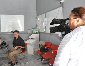 Zaida Collazo films Samuel K. Burlum, and Brian Thomas.
