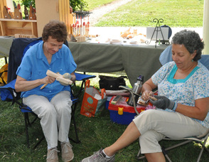 Jersey Hills Wood Carvers Agatha Sherin, and Alice Reines, busy at whittling.