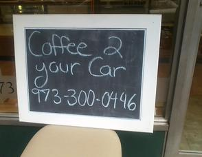 Sign from The Seven Acre Baker alert drivers they could deliver coffee to their cars for them, as they waited for gas.